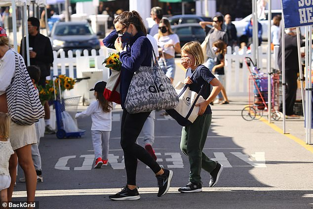 Easy like Sunday morning: The youngest of Garner's three children wore green sweatpants, a navy blue t-shirt and black running sneakers