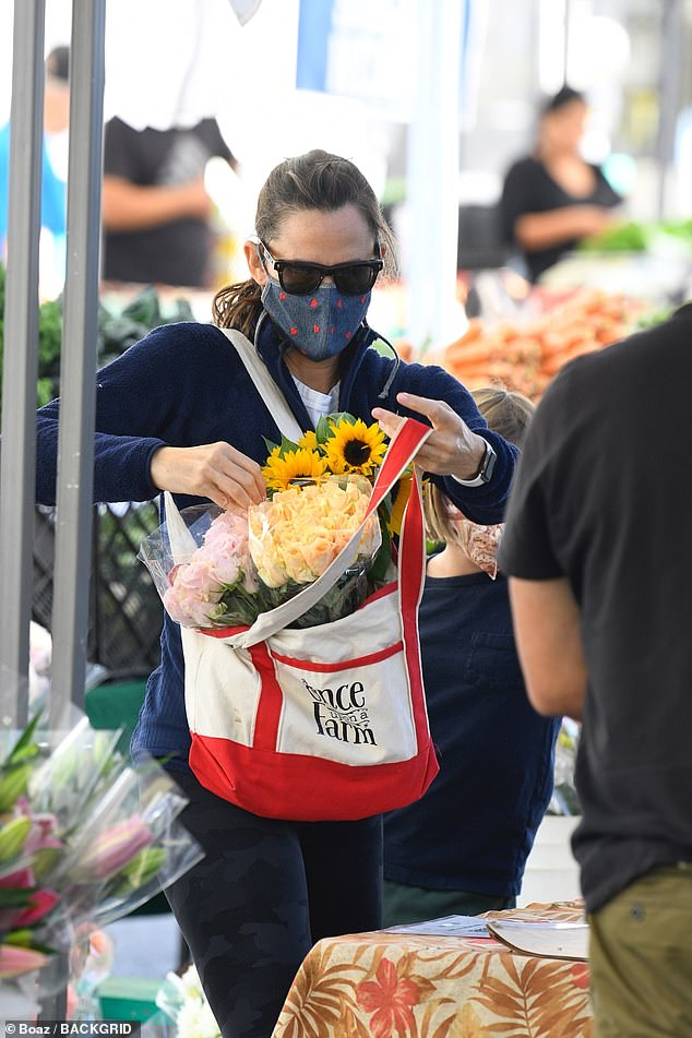 Gorgeous: The actress bought several bouquets of flowers during their trip