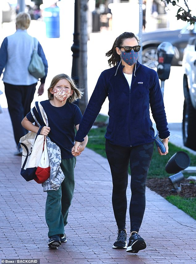 Sweet: The pair shared a number of adorable moments while out shopping together, which included plenty of hand holding