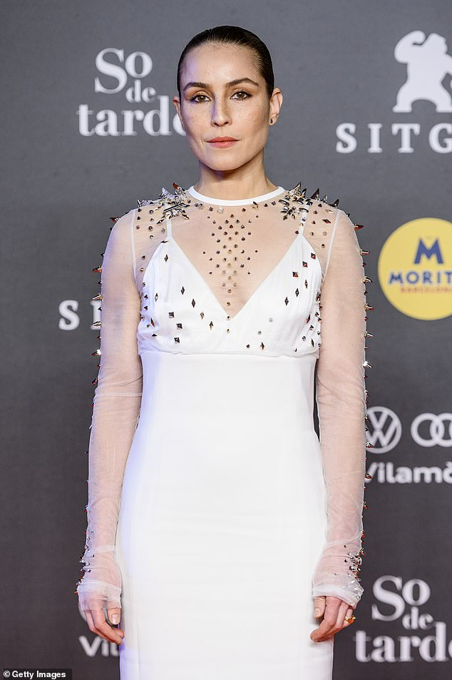 Glamour: Noomi Rapace, 41, looked stylish in a studded mesh white gown as she attended The Lamb premiere at the Sitges Film Festival on Sunday