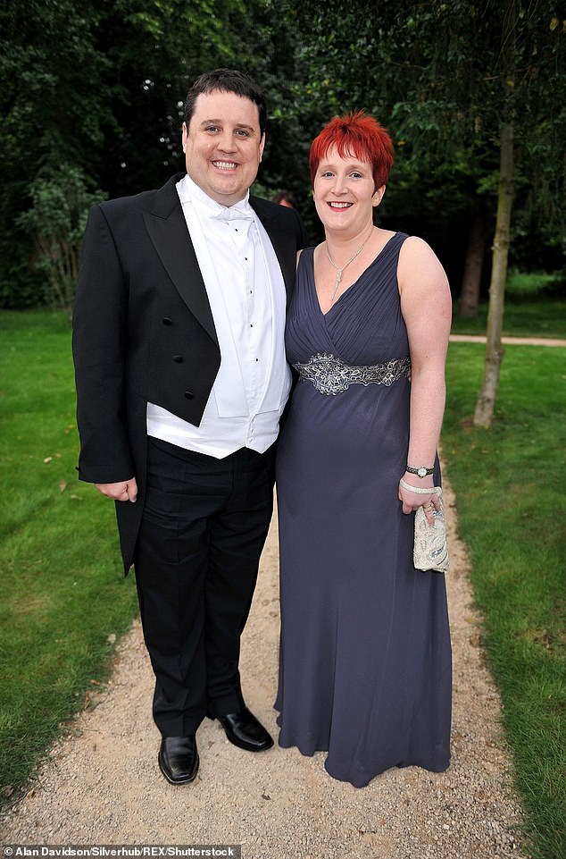 Loved up:Kay, whose 2010-11 tour made it into the Guinness World Records after he performed to more than 1.2million people, lives with his wife Susan and their three children (pictured in 2009)