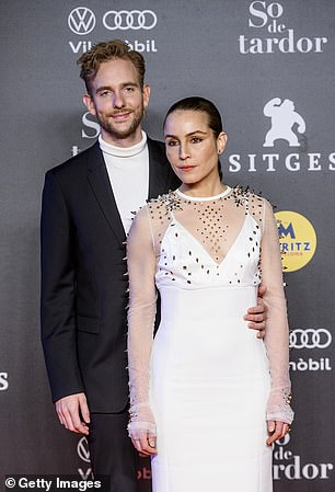 Having fun: She later posed with musician Victor Thell who looked dapper in a black suit paired with a white roll neck