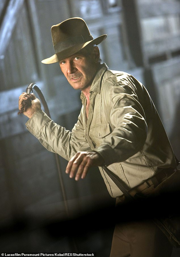 Recognised: The actor posed in the middle of the doppelgängers while wearing his iconic costume; pictured inIndiana Jones and The Kingdom Of The Crystal Skull in 2008