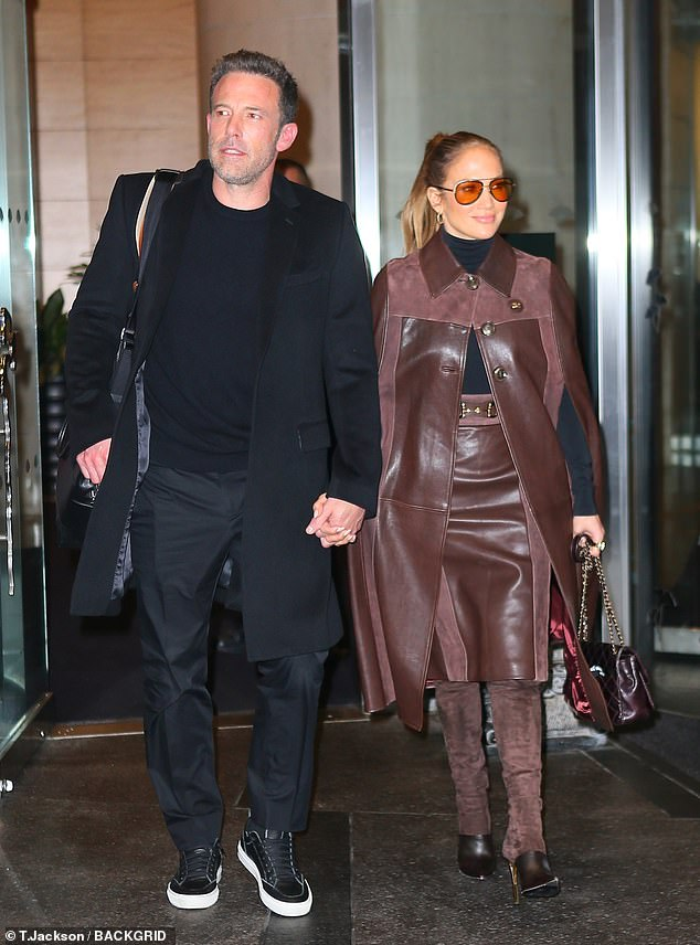 Loved-up: Jennifer Lopez, 52, and Ben Affleck, 49, held hands sweetly as they checked out of the Mandarin Hotel in New York City on Sunday