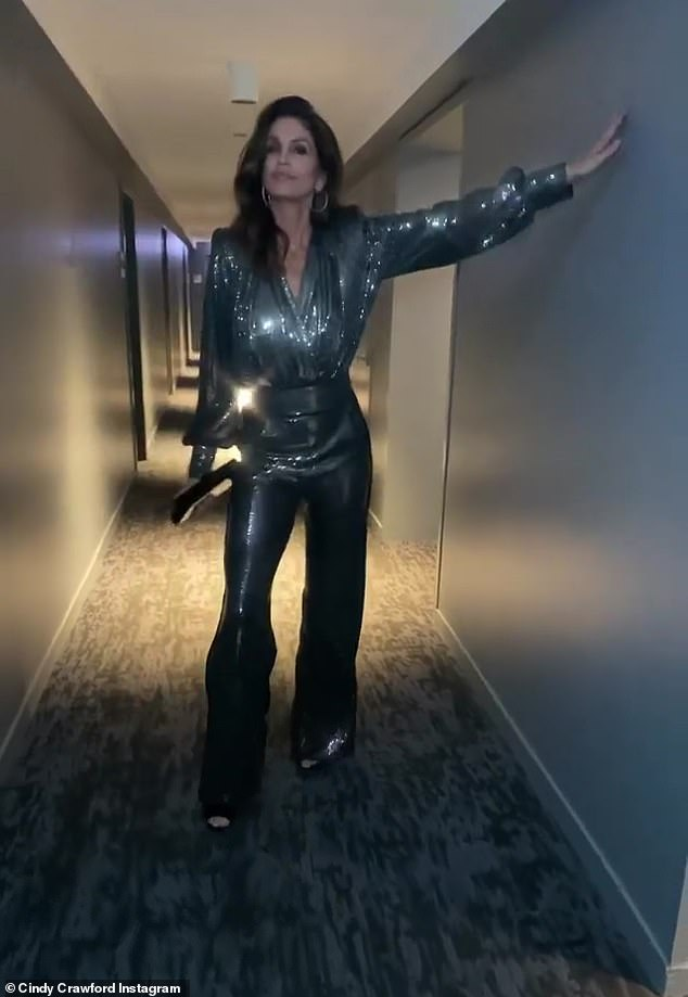 Fashionista: Crawford paired up her sparkling ensemble with black heels, a clutch purse, and styled her dark brown tresses long and flowing past her shoulders with a part on the left
