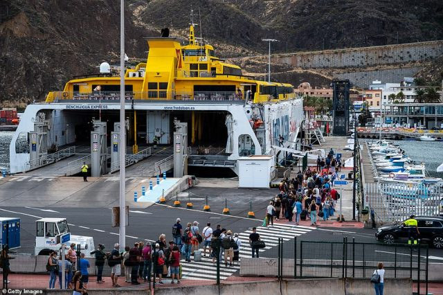 People wait to board a ferry to Tenerife at the port of Santa Cruz de la Palma on Saturday following the eruptions