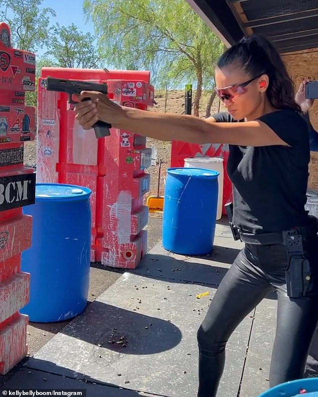 Lara Croft 2.0! Kelly Gale wore tight leather trousers as she fired off a handgun at a shooting range while filming her new movie The Plane