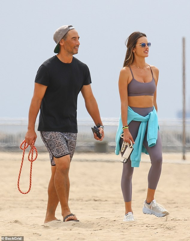 Handsome couple:Last week the leggy stunner enjoyed a beach day with her beau, fellow model Richard Lee