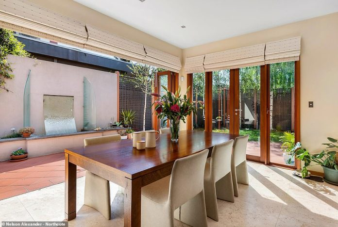 The back doors open completely to combine the indoor and outdoor spaces