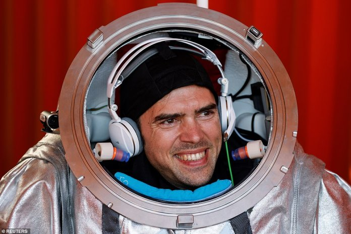 Robert Wilde, a physicist and first responder, wears his space gear during media day, before he, and five others go into isolation for the next four weeks.