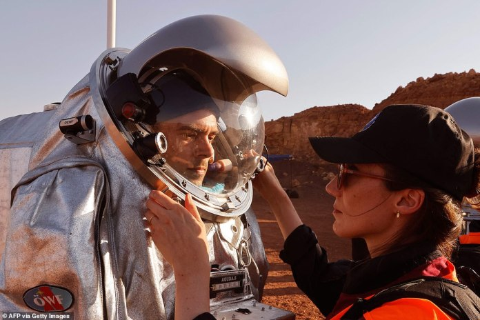 This is not just a test of human experience in the desert, as the crew will also simulate a range of human-robotic Mars surface activities, including wearing a spacesuit, such as it being set up by a technician.
