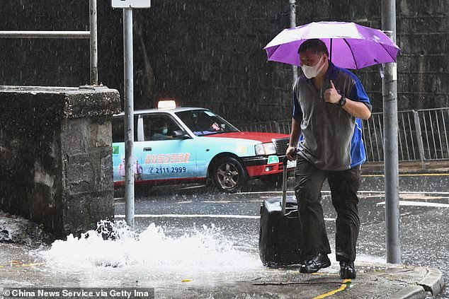 Hong Kong authorities issued its third highest storm warning on Saturday, shutting down transport networks, schools and offices as the typhoon lashed the northern South China Sea