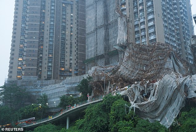 Typhoon Lionrock battered Hong Kong on Friday and one female construction worker was killed when scaffolding (pictured) collapsed in the Happy Valley suburb