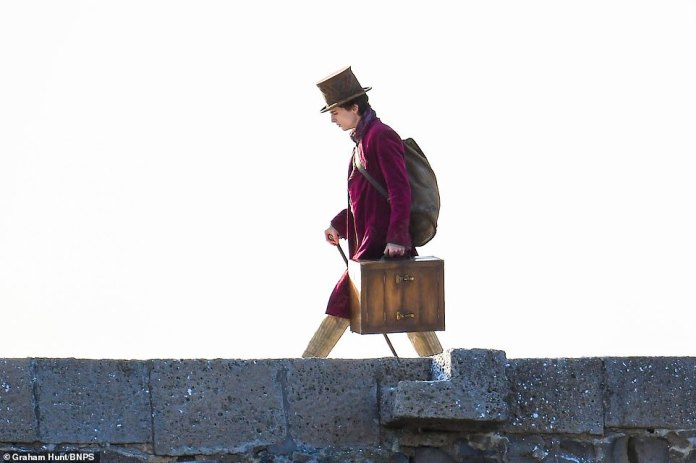 Costume:The actor, 25, could be seen sporting the character's purple coat and dark brown top hat as he filmed an outdoor scene for the prequel, simply called Wonka