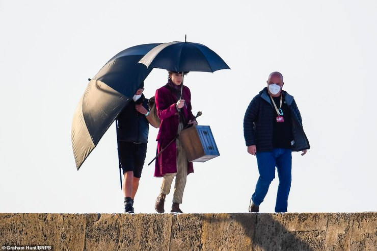 On location:Timothee Chalamet looked well and truly in character as he filmed scenes for the new Willy Wonka film at Lyme Regis in Dorset on Monday
