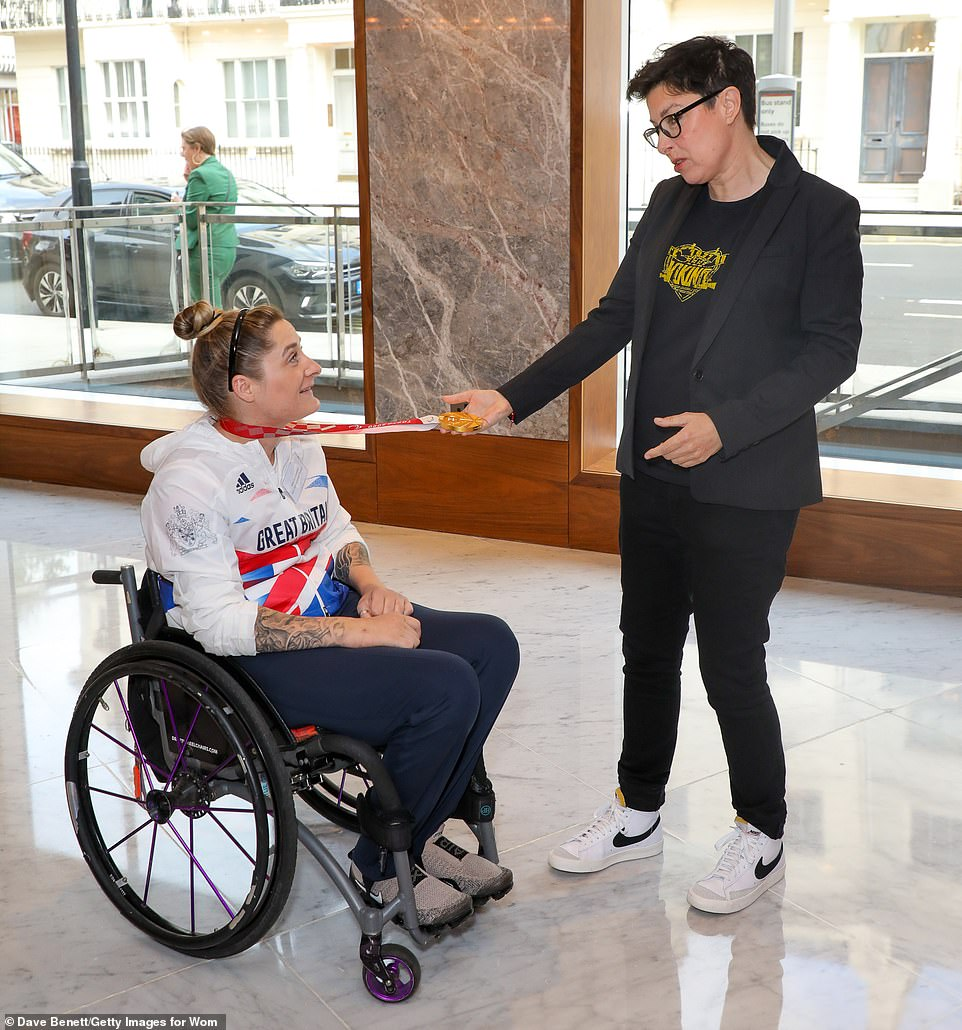Special day: Sue Perkins greets award winnerKylie Grimes at the Royal Lancaster Hotel on Monday afternoon