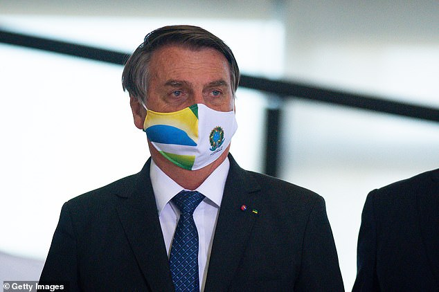 Brazilian President Jair Bolsonaro has opposed COVID mitigation measures, even as the country crossed 600,000 virus-related deaths on Saturday.  Image: Bolsonaro arrives in Brasilia in May 2021 to announce the massive acquisition of intubation drugs to treat COVID-19 patients