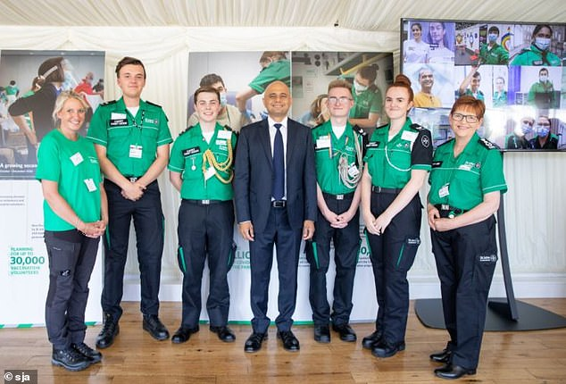 Health Secretary Sajid Javid poses with hero vounteers and staff at the thank-you reception