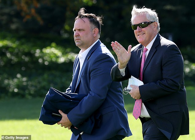 FormerAssistant to the President Dan Scavino (L), seen here with former White House Chief of Staff Mark Meadows (R), was served with a subpoena over the weekend. He denies he was seeking to 'avoid or evade' it. He was finally served when a process server brought it to Mar-a-Lago