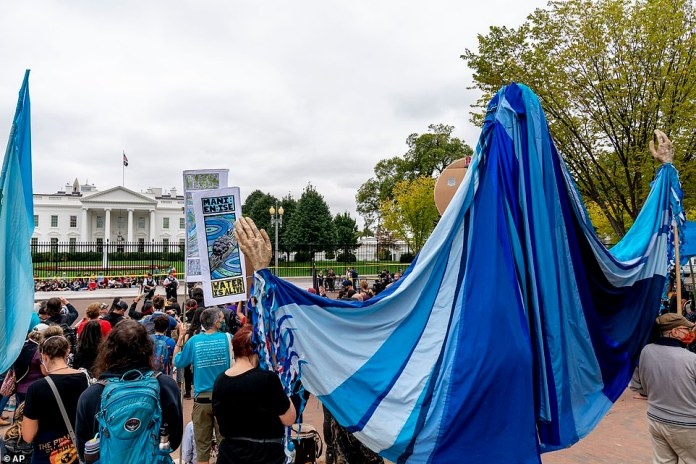 While the Bidens spent the holiday away from Washington indigenous and environmental activists protested outside the White House.The demonstrations was part of People vs. Fossil Fuels protests across the country by a coalition of groups