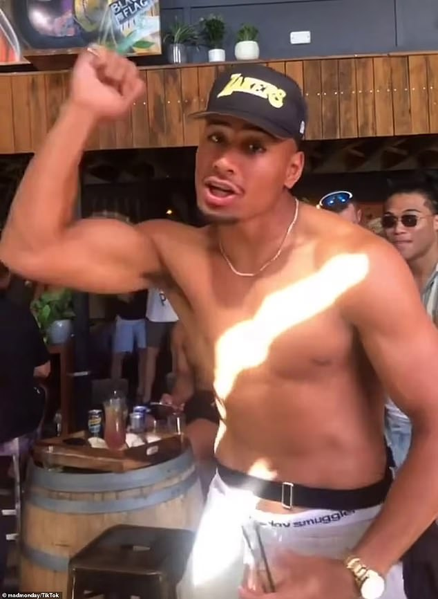 Panthers wingerStephen Crichton (pictured) is shirtless in a Lakers cap and holding a cocktail glass while rapping to Stormzy's hit Shut Up during the club's Mad Monday celebrations