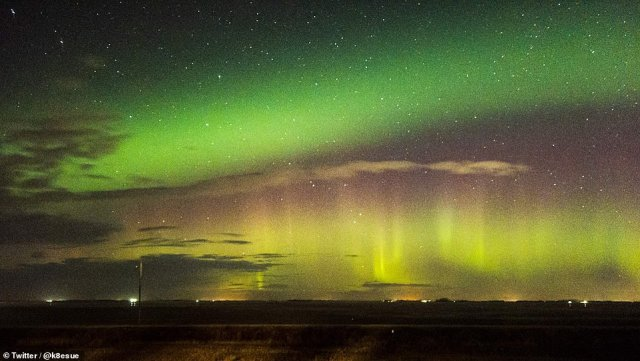 Green and pink light shows usually occur when electrically charged particles from the sun emit gases into the Earth's atmosphere, causing them to glow.  Photo: Northern Lights as seen last night at Corman Park No. 344 in Saskatchewan, Canada.