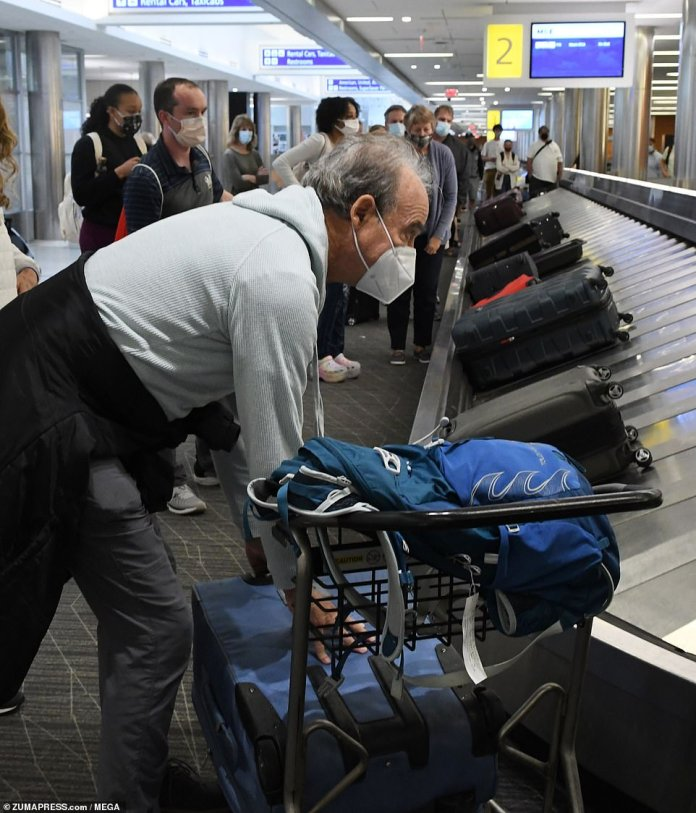 A Southwest passenger claims his baggage at General Mitchell International Airport in Milwaukee on Monday