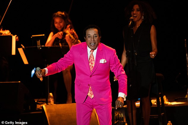 Smokey Robinson, pictured performing in Los Angeles last month, has revealed he nearly died last December after a terrifying battle with Covid-19