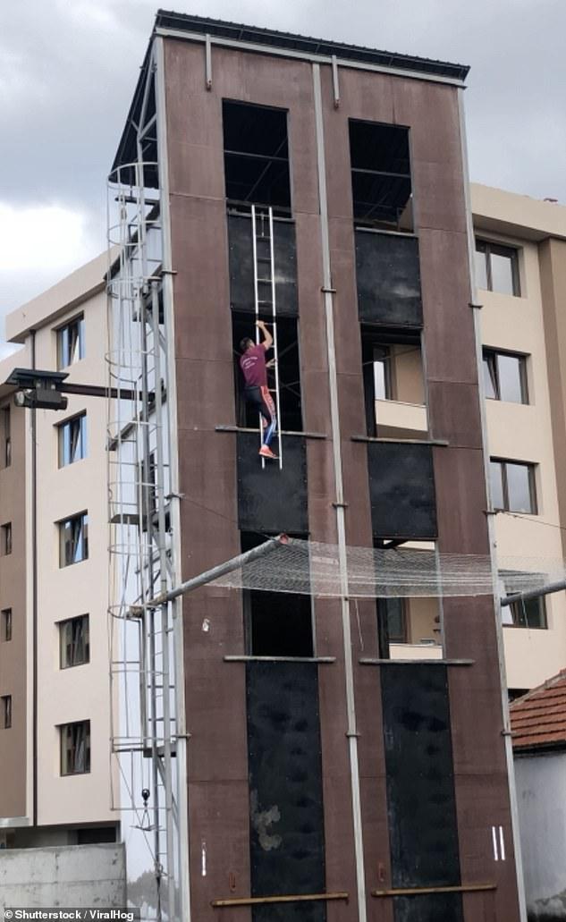 The Bulgarian firefighter was rapidly climbing the building as part of firesport training in Stara Zagora, Bulgaria