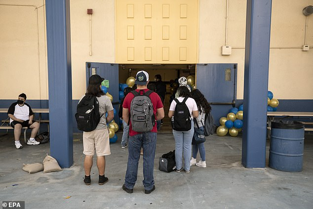 The interim superintendent of LAUSD said, 'People have to be vaccinated or they're not going to be part of the district.  Pictured: Students wait in line to get vaccinated at their high school in El Sereno, east of Los Angeles, August 2021