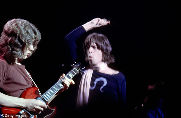 Mick Jagger is pictured in 1969 at the Altamont Speedway festival in California - the first time they played Brown Sugar. He is seen with Mick Taylor, who left the band in 1974 and was replaced with Ronnie Wood
