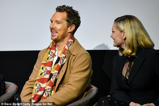 Kirsten Dunst, 39, looked chic in a semi-sheer black and gold dress with co-star Benedict Cumberbatch on Tuesday for The Power of the Dog screening at London's Ham Yard Hotel.