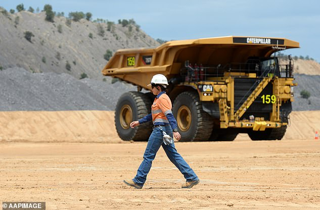 But some employers are going beyond government mandates and requiring their staff to have had two immunisation doses to be allowed back into the office.Mining giant BHP last week announced that from January 31, unvaccinated staff, contractors and visitors would be banned from entering its Australian work sites (pictured is a BHP coal mine at Moranbah in central Queensland)