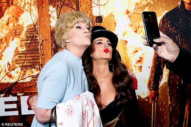 Pucker up: Curtis, who was dressed up as her mother Janet Leigh's character from Psycho, posed for cameras with their lips puckered for one playful shot