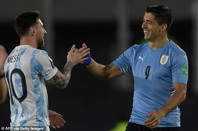 Messi and Suarez share a moment to catch up while meeting on international duty this month