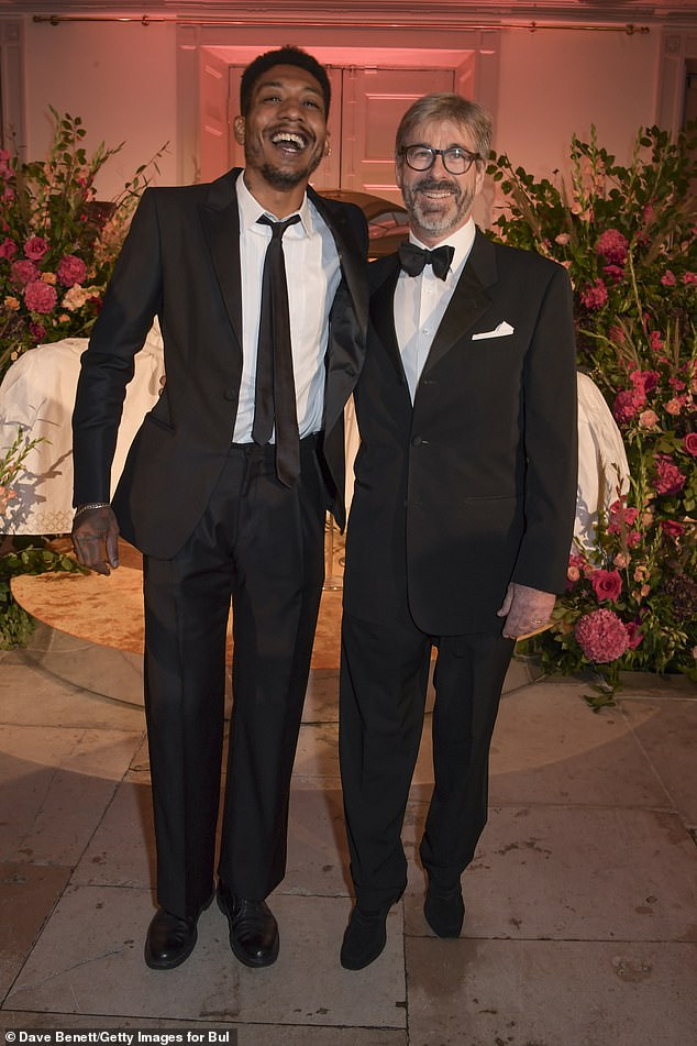 Good times: MusicianHonor Titus was all smiles as he posed alongside a pal at the swanky event