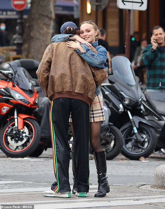 Loved-up:Lily-Rose, 22, was all smiles as she she stopped to hug her French rapper beau during the PDA-filled outing