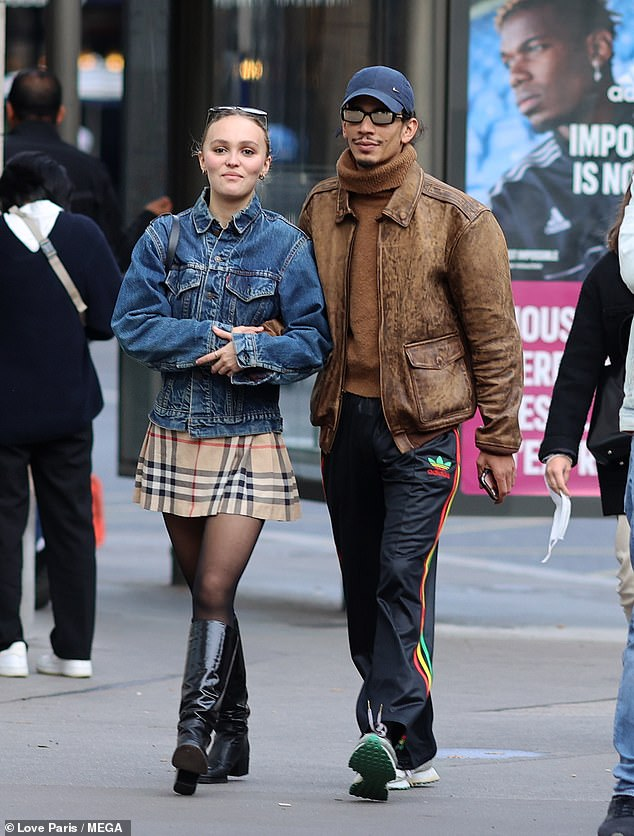Just the two of us:Lily-Rose Depp was the picture of happiness on Monday as she enjoyed a stroll with new boyfriend Yassine Stein in Paris