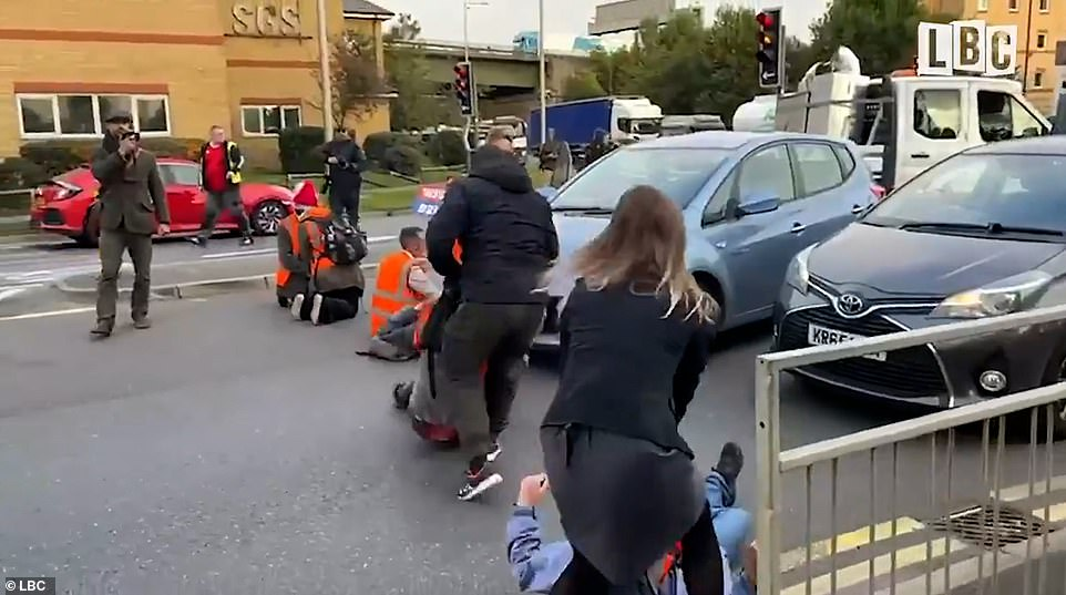 Motorists got out of their cars and dragged the protesters off the road at Thurrock today