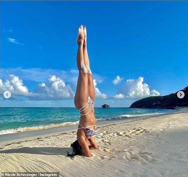 , Nicole Scherzinger sizzles inwrap-around bikini and peach sarong as she performs TikTok dance, The Today News USA