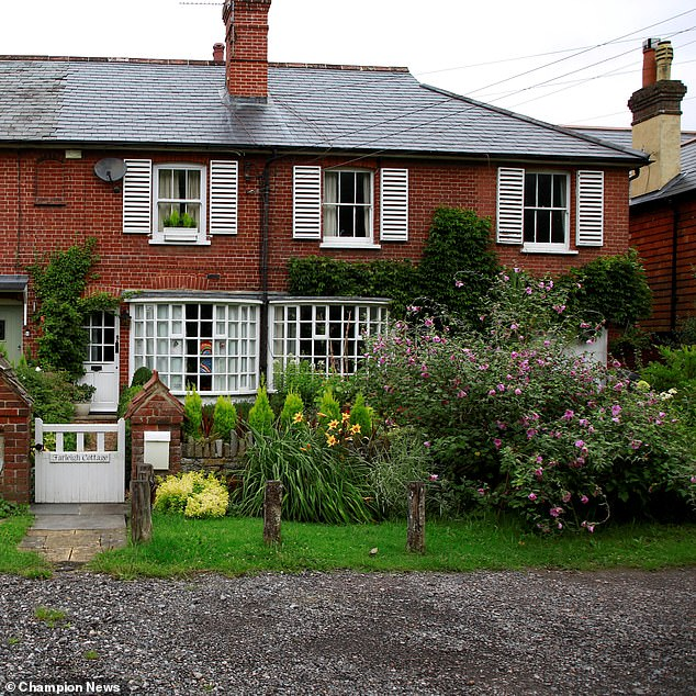 The adjoining homes of feuding neighbours Mrs Williams and Mrs Pilcher in Dunsfold, near Godalming, Surrey