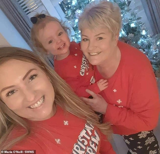 Ms O'Neill (pictured with her daughter Mila and mother) was scrubbing off a fake tan in the shower when she found a lump in her breast, which she was told was cancer in July.