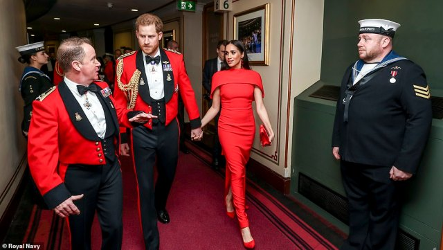 Major General Matthew Holmes welcomes Prince Harry and Meghan Markle to the Royal Albert Hall in London in March 2020