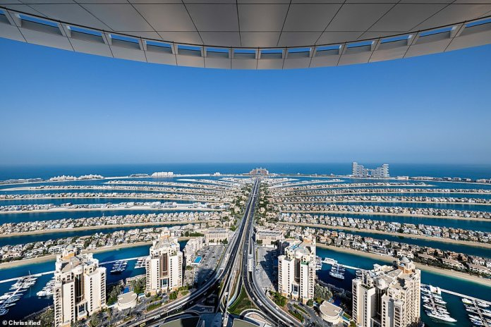 To the west, the Palm Jumeirah archipelago (pictured above) stretches out into the Persian Gulf