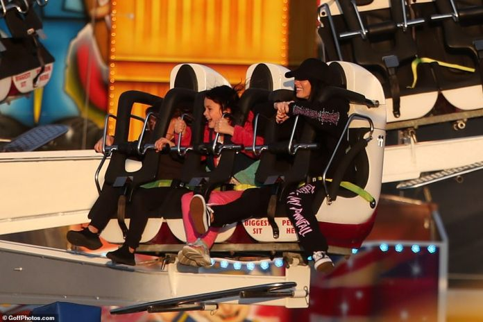 Living life on the edge: Megan seemed in high spirits as she rode on the ride