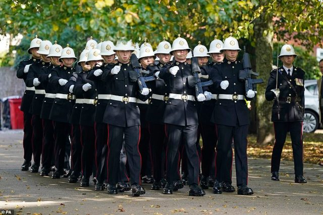 Top British military officials have today gathered to pay their respects at the funeral of the former head of the Royal Marines. Pictured:A detachment of Royal Marines arrive for the funeral of Major General Matthew Holmes