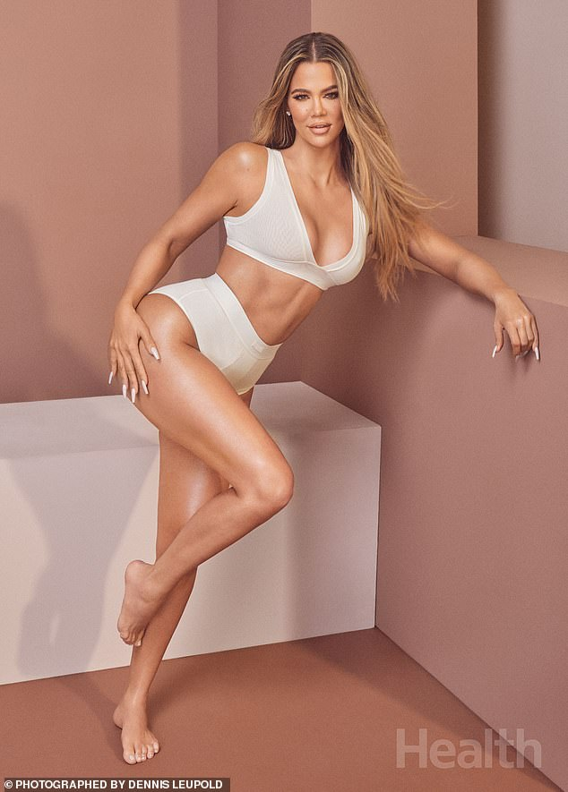 Figure:Another image showed Khloe in a white bra top and matching underwear, highlighting her gym honed body