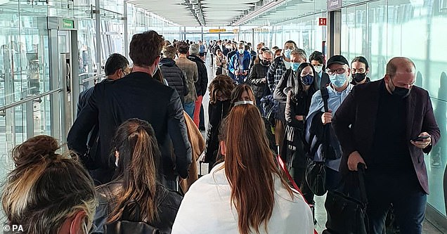 Passengers queue for the arrivals hall at London Heathrow Airport's Terminal 5 last week due to a problem with the self-service passport gate
