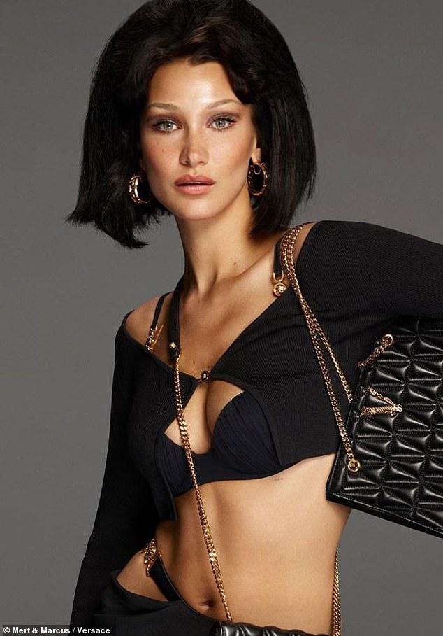 Bikini fever: she wore a black cardigan over a black bikini top. His pants were so low that he exposed his bikini bottom