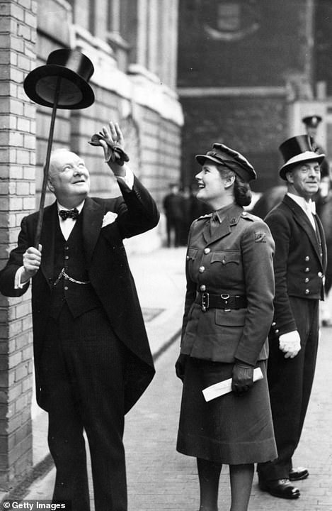 Mr Johnson is not afraid of public political stunts. Whilst Sir Winston was largely more measured, he did entertain onlookers on occasion. Above: The then PM balancing his top hat on his walking stick in 1943